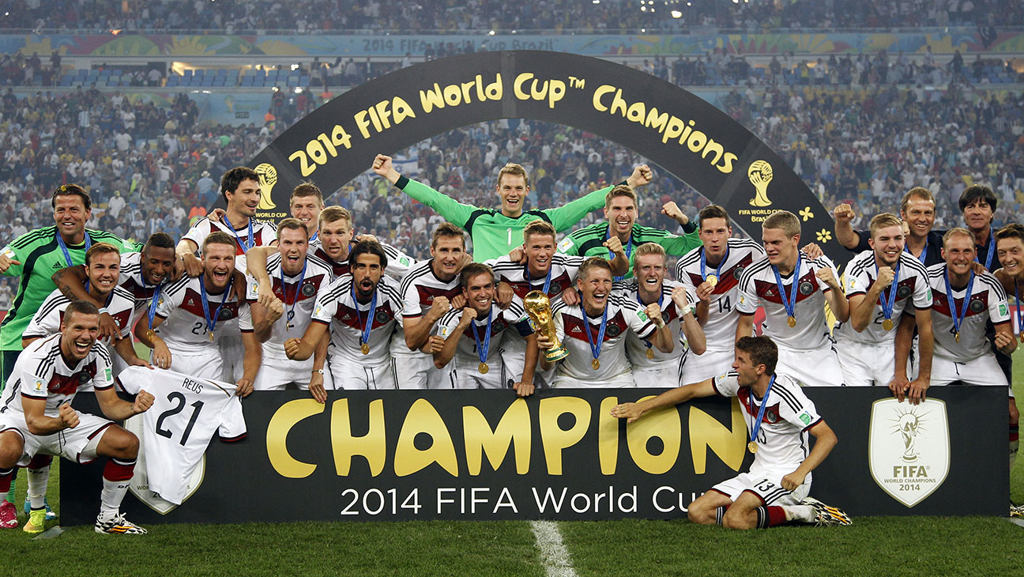Germanys players celebrate with the World Cup trophy after the 2014 World Cup final against Argentina